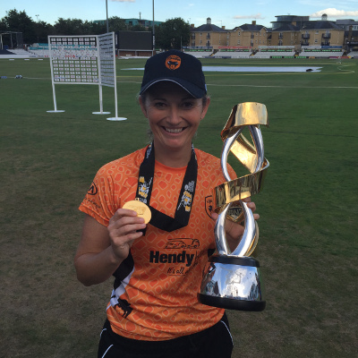 Charlotte Edwards With The KSL Trophy